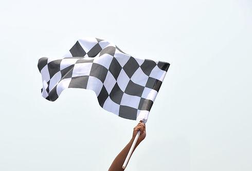 checkered race flag in hand..jpg