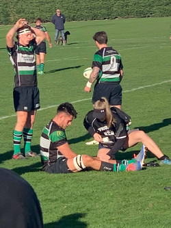 Bronwyn attending to an injury on the field