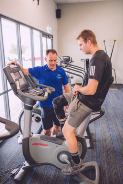 Colin in Empower fitness with a client