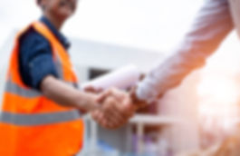 Engineer man handshake with asian busine