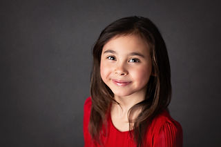 young girl elegantly smiles at the camera,  yound actress headshots, Morris county childer