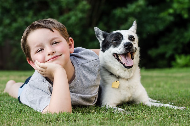 A young boy and his dog.