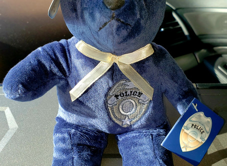 Cops Gift Teddy Bears to Tots