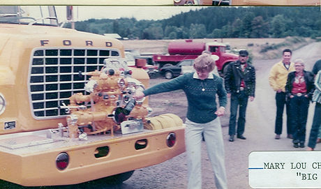 Historical photo of Mary Lou Busch christening an apparatus