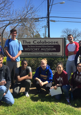 Skyller and students in front of Calaboose