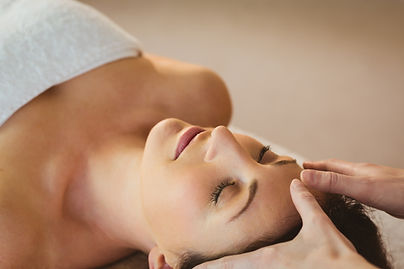 young-woman-having-a-reiki-treatment-in-