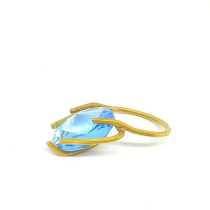 claw ring with blue crystal