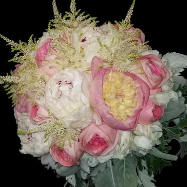 pink and white bouquet featuring peonies, garden roses, astilbes, hydrangeas, dusty miller