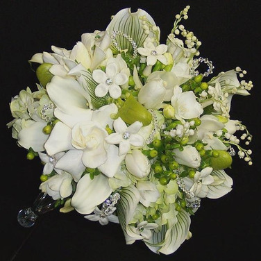 haute couture bouquet: lily of the valley, paphiopedilum orchid, stephanotis, gardenia, calla lily, tulip,                                      cymbidium orchid, freesia, hydrangea, hypericum berry, Swarovski crystals