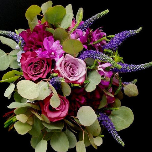 rose, carnation, orchid, veronica, hydrangea mixed bouquet in shades of purple, plum, lavender with Eucalyptus