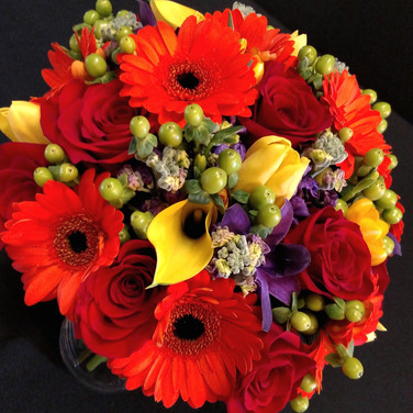 Autumn bouquet featuring roses, gerberas, tulips, callas, freesias, orchids, hypericum berries, stocks