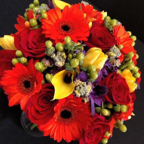 Autumn bouquet featuring roses, gerberas, tulips, callas, freesias, orchids, hypericum berries, stocks