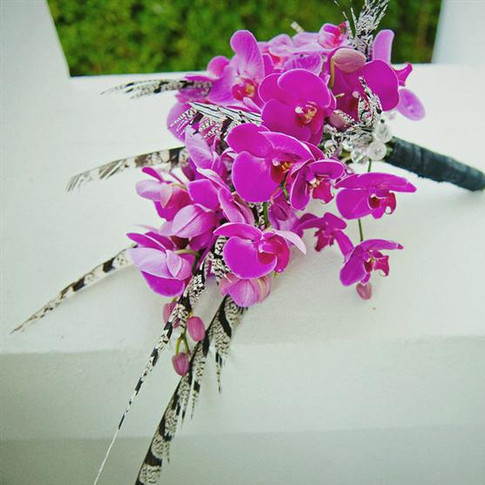 fierce bouquet featuring phalaenopsis orchids, feathers, jewels