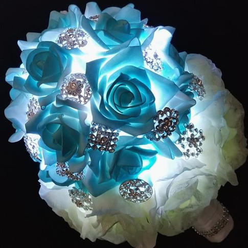 brooch and rose bouquet with cool white lights