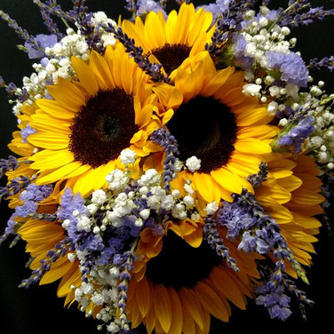 Summer bouquet featuring sunflowers, lavenders, baby's breath, statice