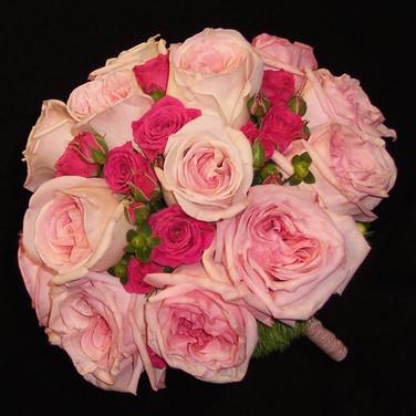 pink bouquet featuring garden roses, spray roses, green hypericum berries, green dianthus
