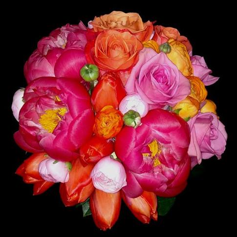 Spring bouquet featuring peonies, tulips, roses, ranunculi