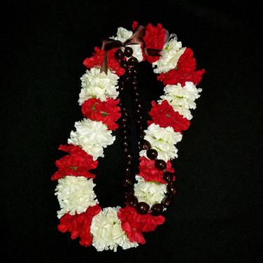 carnation lei ($60+) kukui nut lei ($15)