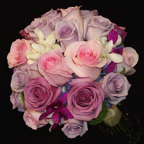 rose and orchid bouquet in shades of pink and purple with touch of white and green