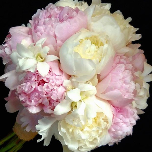 Spring bouquet featuring peonies and orchids