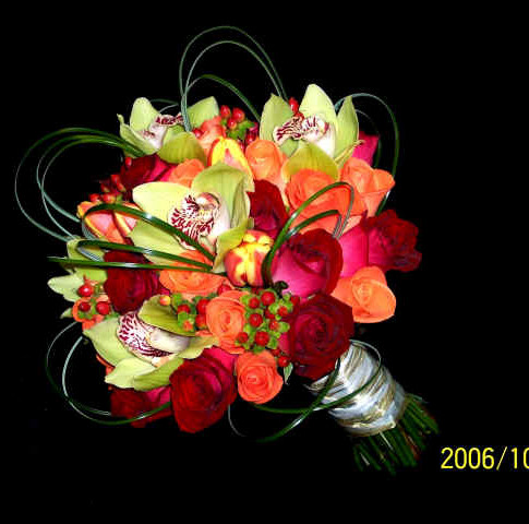 colorful bouquet featuring roses, tulips, orchids, hypericum berries, grass loops