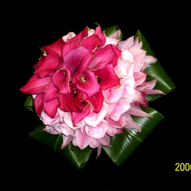 pink bouquet featuring mini callas, roses, orchids, ti leaves