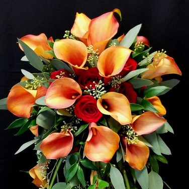 traditional cascading bouquet featuring calla lilies and roses