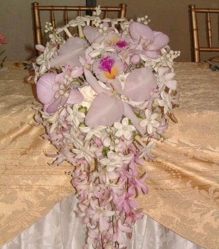 orchid, lily of the valley, gardenia and stephanotis bouquet