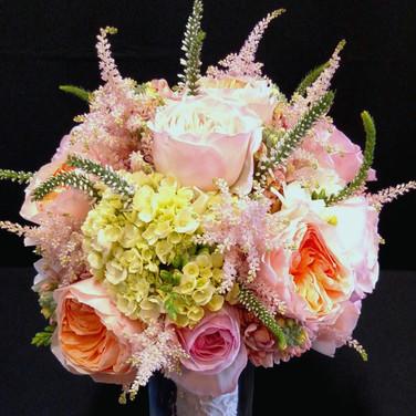 garden bouquet featuring David Austin® Roses (Juliet and Keira), green Hydrangea, blush Astilbes, white Veronicas, white Freesias, peach Stocks