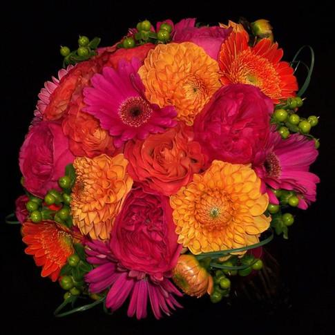 colorful bouquet featuring garden roses, dahlias, gerberas, hypericum berries, grass loops