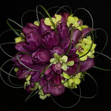 modern bouquet featuring purple tulips, purple mini calla lilies, green dendrobium orchids, grass loops