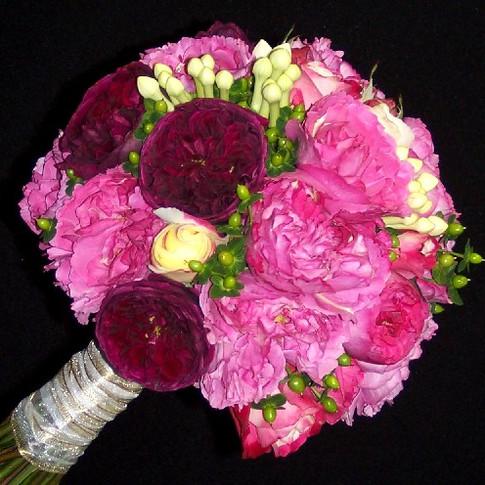 fragrant bouquet featuring garden roses, stephanotis buds, hypericum berries