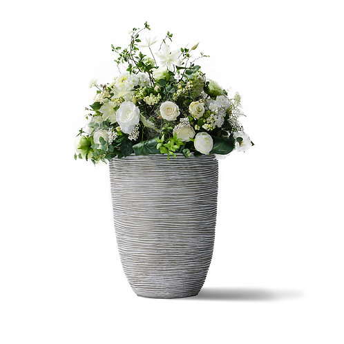 Silk flower and white in a large pot