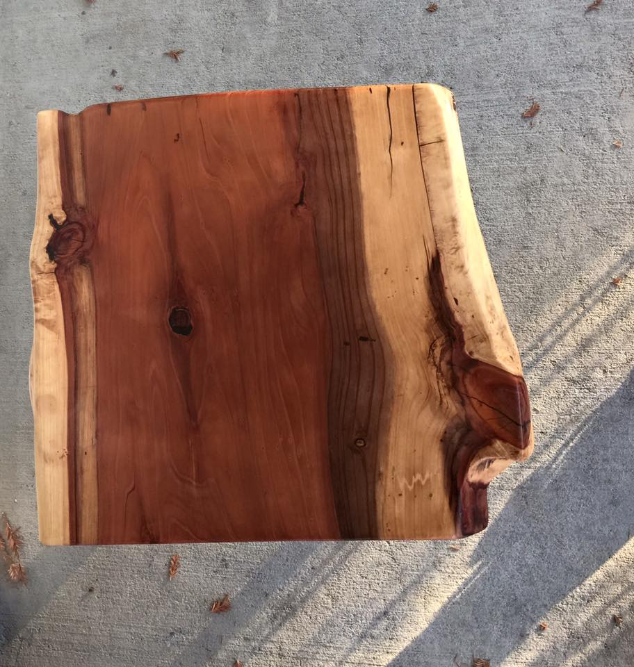 Solid slab of redwood coffee table