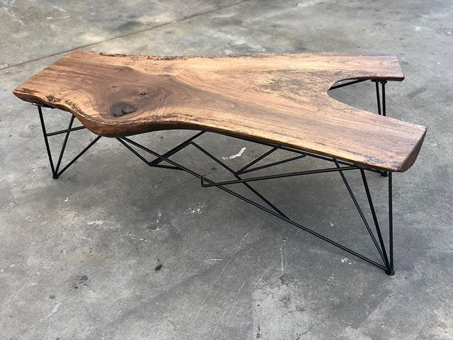 One of a kind walnut slab coffee table .