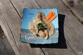 A plate of our pierogies with Local artist Laura Van Der Linde's work .