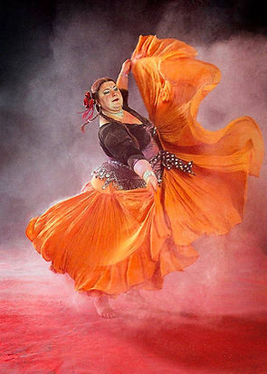 Sarah SK of Boheme Tribal Belly Dance with orange skirt, photo by Anita Falk