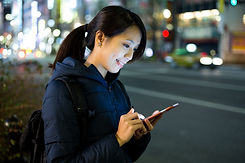 Woman read messag on cellphone at street