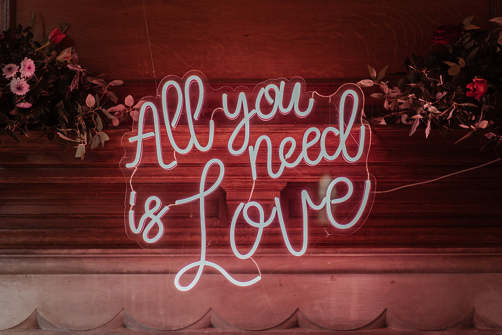 All You Need is Love neon sign on fire mantel piece at Balcombe Place