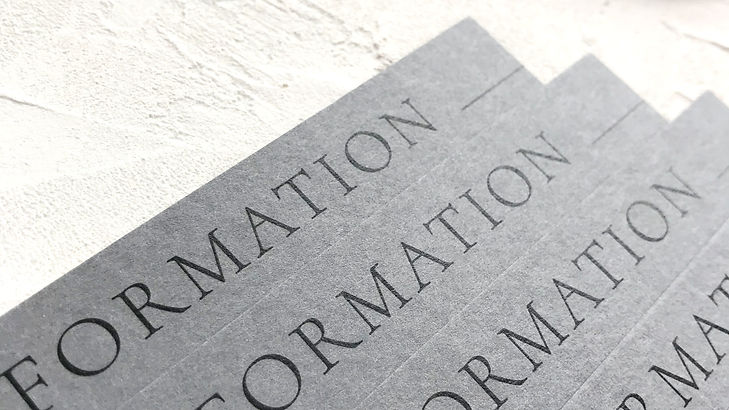 Information card for a modern wedding stationery suite in tones of grey with expressive typography for the design led couple