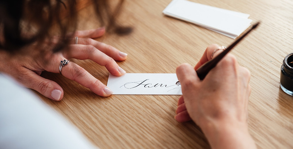 Hand writing calligraphy placecards.jpg