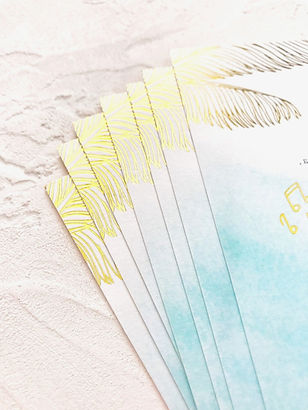 Order of the day card for a destination wedding with hot foil details