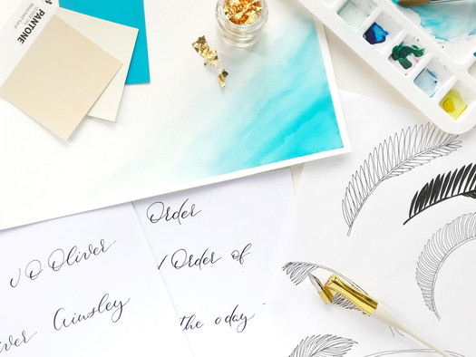 Stationery design process with paper, ink, colour palettes and gold foil