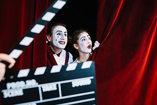 clapperboard-in-front-of-excited-mime-co