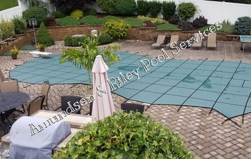 finished pool safety cover installation, pool safety cover, solid safety cover, smart mesh safety cover, walking on pool safety covers,