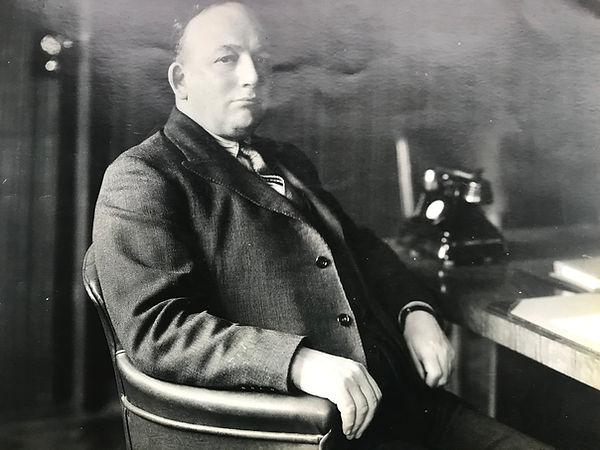 T G John in 1937
