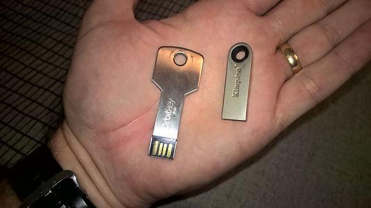 Left Orbitkey Thumb Drive, Right KeySmart Thumb drive