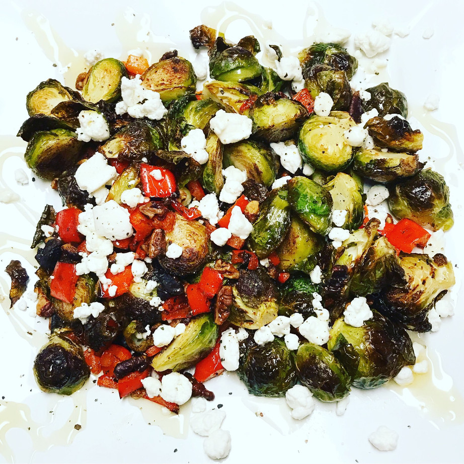 Crispy Roasted Cinnamon Nut Brussels Sprouts  topped with Goat Cheese and Honey
