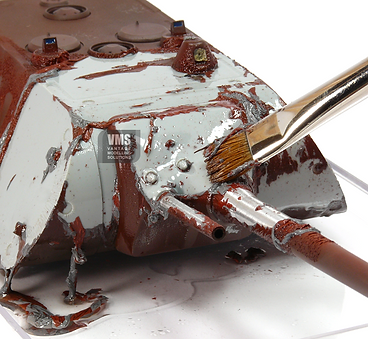 Removing paint from a scale model