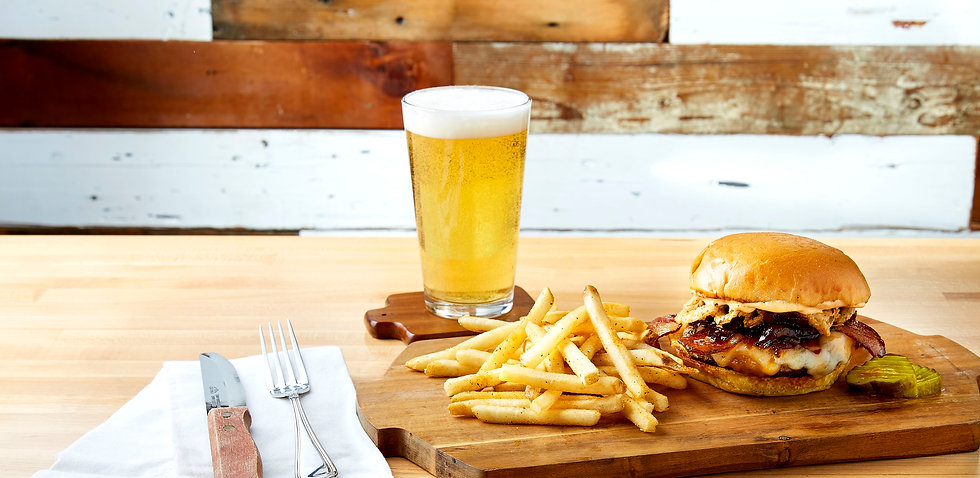 Pint of beer, fries and a burger